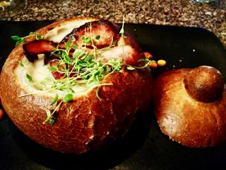 Cheese soup in a bread bowl